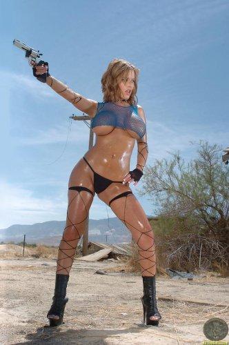 Jenny McClain with pistol